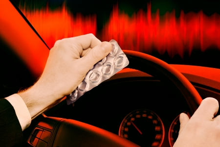 dangerous driving - Caution  Driving under the influence of medications and or alcohol can be dangerous  Stock Photo