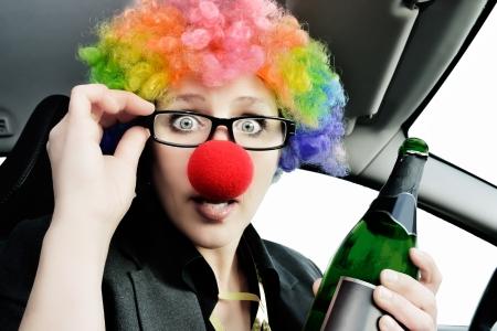 bottle nose: a women blazer holding wine in car