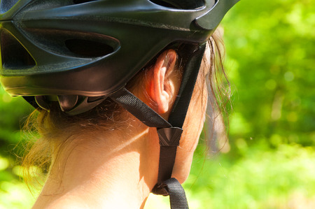 bicycle helmet: Attractive female bicycle rider standing and looking Stock Photo