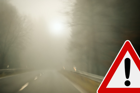 Caution - foggy road  photo