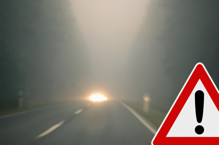 road autumnal: Caution - foggy road - oncoming traffic