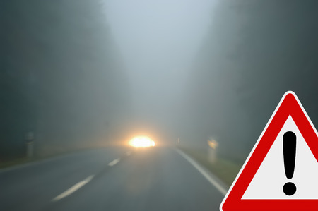 Caution - foggy road - oncoming traffic photo