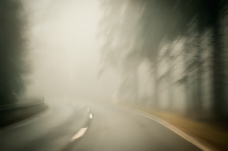 road autumnal: Foggy morning on a winding country road
