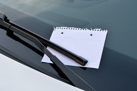 blank sheet of paper under a windshield wiper photo
