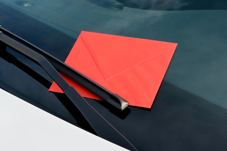 loveletter under a windshield wiper photo