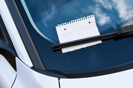 sheet of paper under a windshield wiper photo