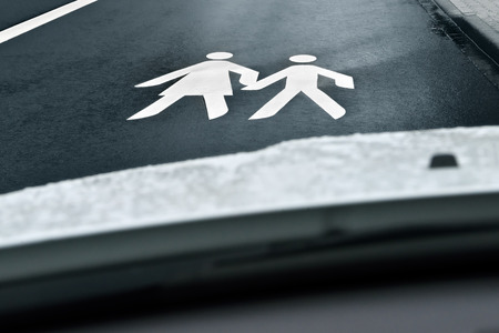 motorists: way to school - children crossing the street Stock Photo