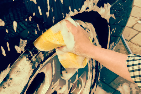 washing a car by hand photo