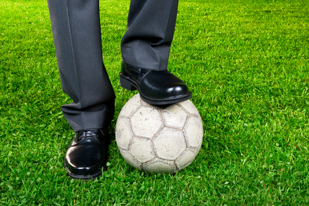 career - businessman playing with soccer ball photo