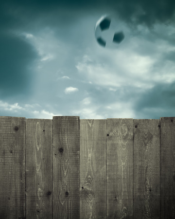 Wooden fence and soccer ball photo