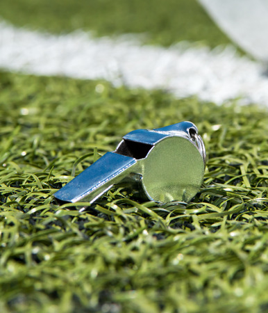 Whistle on a soccer field photo