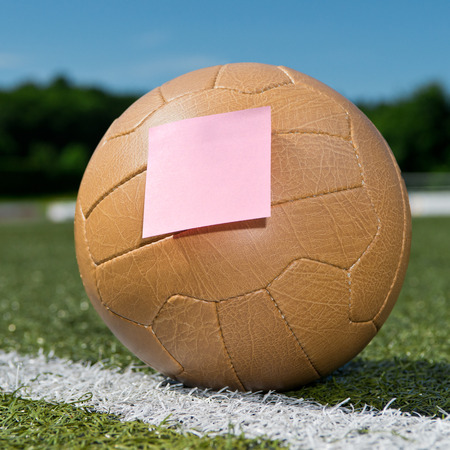 Soccer ball and sticky note photo