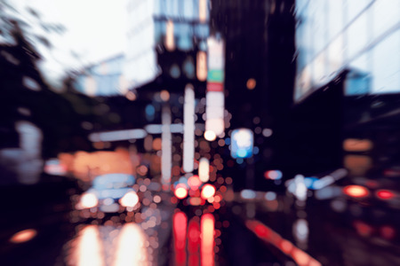 Bad weather driving in downtown - business district 스톡 콘텐츠