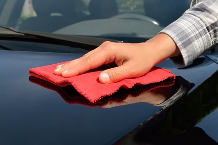 detailing: Car care - Polishing a black car Stock Photo