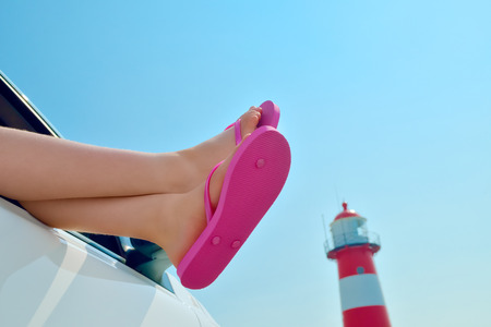 Girl Relaxing in a Car at the Sea