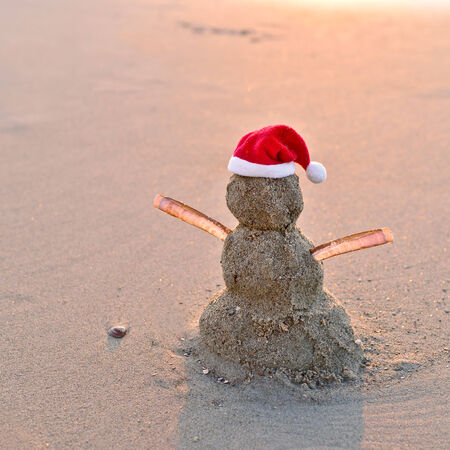 Hot Christmas Vacation - sandy snowman with santa hat photo