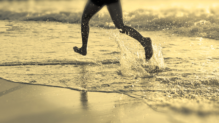 At the Sea - Running on the Beach at Sunset photo