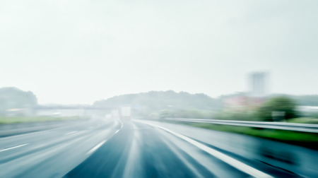 hydroplaning: Bad Weather Driving - Driving on a Highway on a Rainy and Misty Day