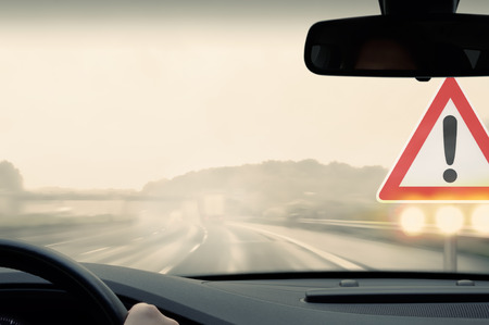 smoothness: Bad Weather Driving - Caution Stock Photo