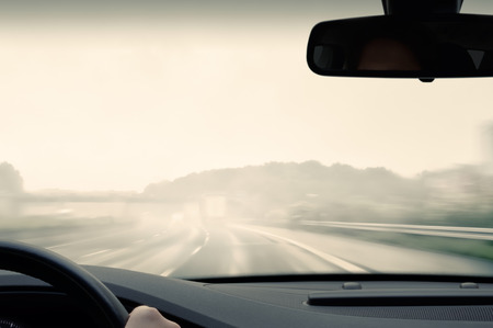 hydroplaning: Bad Weather Driving - Driving on a Freeway on a Rainy and Misty Day