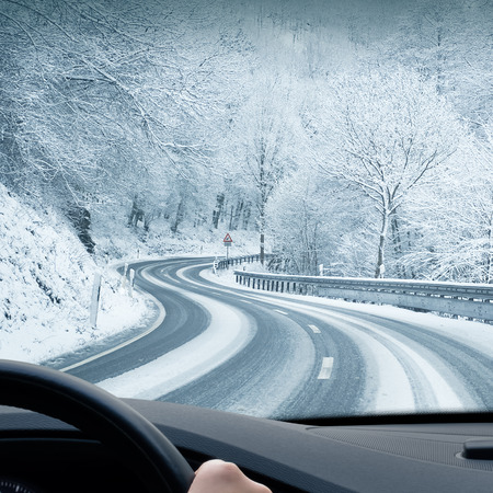 driving: Winter Driving - Curvy Snowy Country Road Stock Photo