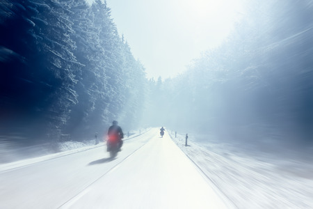 motorcycling: Motorcycling - Motorbike drivers on a sunny country road (motion blur)