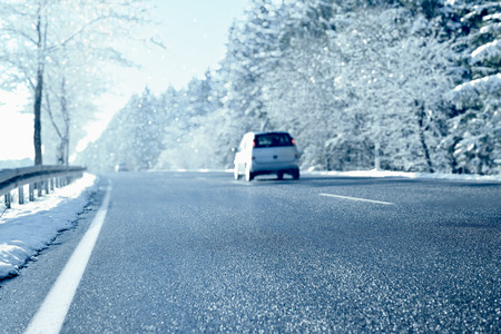 sleet: Winter Driving - Country road on a sunny winter day