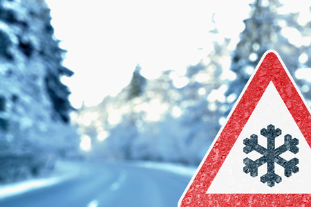 Abstract winter background with Driving Warning Sign photo