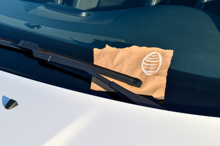 windshield: Message under a Windshield Wiper with Easter Egg and copyspace Stock Photo