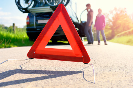 road assistance: Car Trouble on a Holiday trip - family is waiting for road assistance Stock Photo