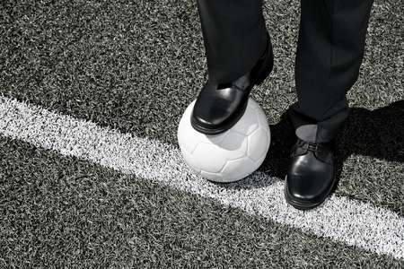 touchline: Manager with soccer ball on the Touchline