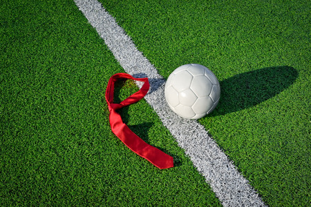 Soccer Ball and Tie on a Soccer Field photo
