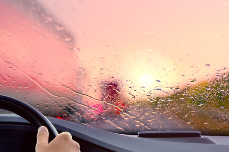 brake: Driving on a Highway at Sunset When it starts to rain