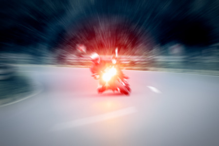 motorcycling: Motorcycling - Motorcyclist is taking a corner at high speed