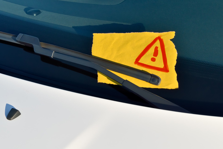 wiper: Message under a Windshield Wiper