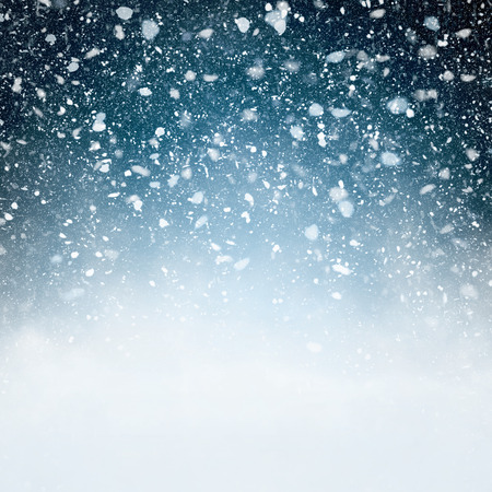 sky: Snowfall with Blue Background - Fluffy snowflakes falling in front of a blue background with vignette