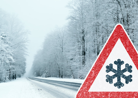 tire: Winter Driving - Caution Risk of Snow and Ice Stock Photo