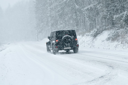drifting ice: Winter Driving - risk of snow and ice Stock Photo
