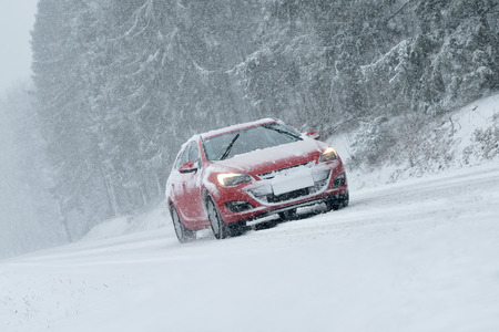snow drift: Winter Driving - risk of snow and ice Stock Photo