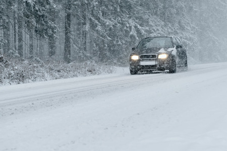 Winter Driving - country road in winter - of snow and ice risk Stock Photo - 47448804