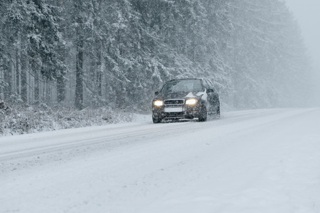 drifting ice: Winter Driving - country road in winter - of snow and ice risk