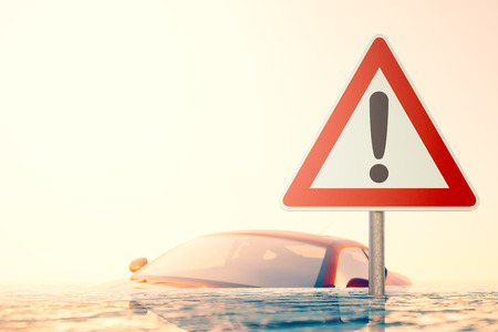 flood water: Warning sign standing in flood water in front of a flooded car