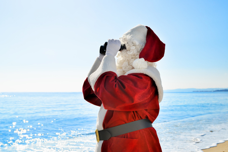 Christmas Vacation - Santa standing on the beach with binoculars, looking for à ¢ à ¢, ¬ |