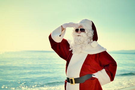 Christmas Vacation - Santa standing on the beach, looking for à ¢ â,¬ | Santa is standing on the beach and he is looking for something or somebody.