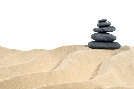 On the Beach - Balanced stones on a sand dune in front of a white background - clipping path included Stok Fotoğraf