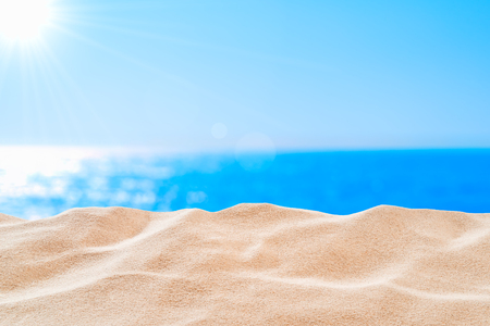 On the beach - sand dune in front of beautiful azure sea on a sunny day Stok Fotoğraf