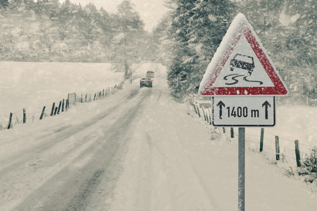 Winter Driving - Heavy snowfall on a country road. Driving on it is dangerous?