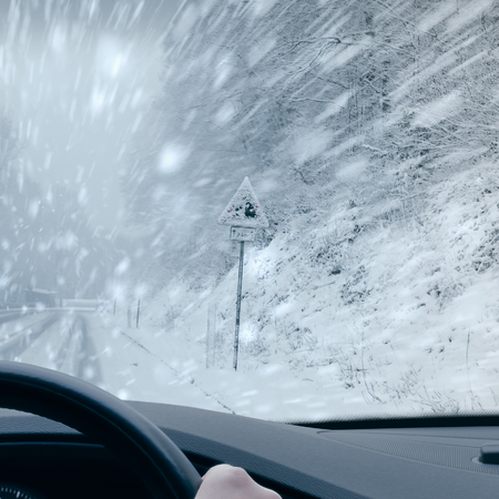 Winter Driving - Heavy snowfall on a mountain road
