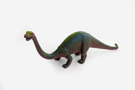 Plastic diplodocus toy isolated on white background