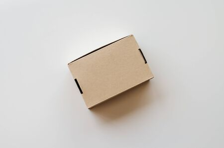 Brown cardboard box on white background. Top view